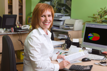 Woman at her workplace for bookkeeping services using MYOB software