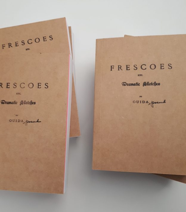 """books with covers made of rough chipboard paper, showing cover title """"FRESCOES etc. Dramatic Sketched by OUIDA"""" with the work """"pseud."""" written in cursive next to the name """"OUDIA"""". On one of the books can be seen a glimpse of a vibrant pink paper inside the front cover before the book's actual pages."""