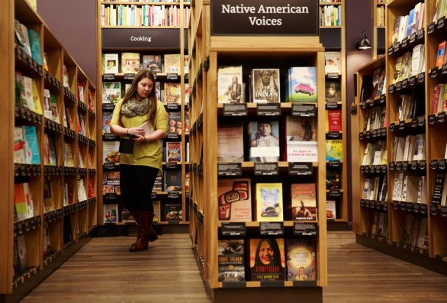 Alyssa Boggs, executive assistant at Amazon, works inside of Amazon Books, the company's first brick-and-mortar store, Monday, Nov. 2, 2015. Amazon Books will open tomorrow Tuesday, Nov. 3, 2015 in Seattle's University District.