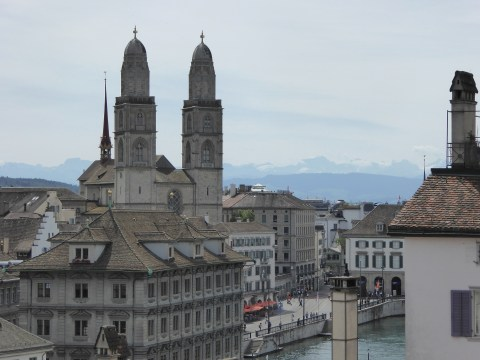 Photo 71: View of the Grossmuenster church and mountains from Lindenhof Park