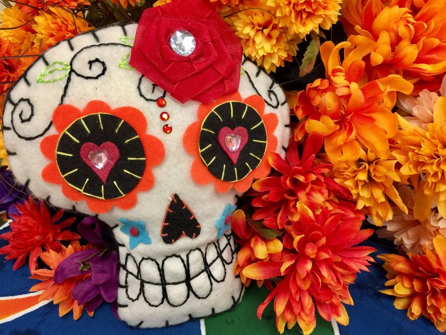 Skull with flowers to day of the death