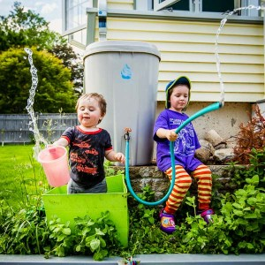 kids play with rain barrel