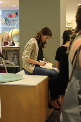 Alexandra Bracken ('The Darkest Minds') signs books for fans.