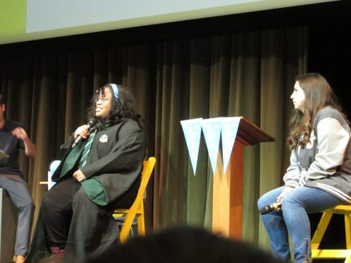 Angie Thomas (in the Slytherin robes) and Victoria Aveyard in her YallWest Letterman jacket