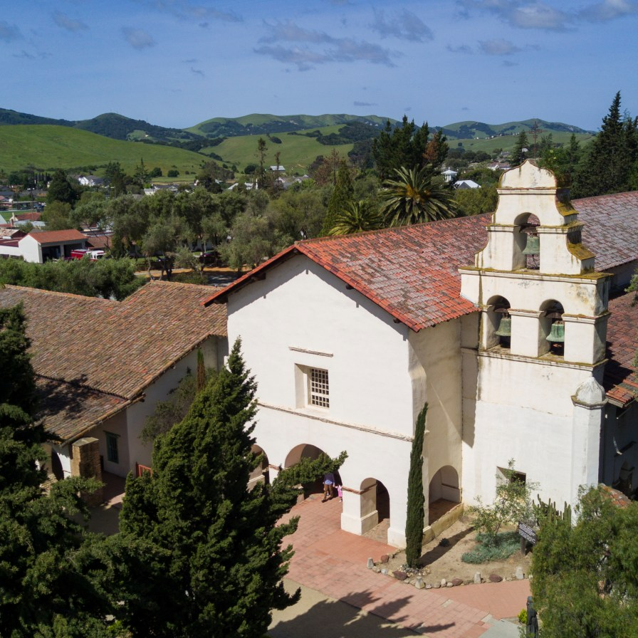 Nestled in a fertile valley surrounded by farms, Mission San Juan Bautista remains a home to a large modern parish.
