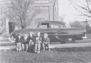 Chief Dispatcher for Duff's Taxi was . . . me (centre) from age 8 to 13.