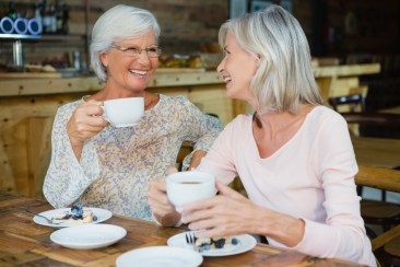 Senior Enjoying Discounts On Coffee