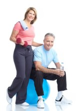 8538380 - gym & fitness. smiling elderly couple working out. isolated over white background