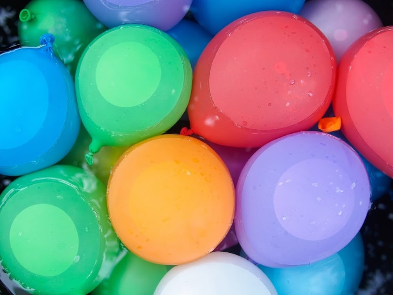 a bucket full of water balloons for outdoor water games