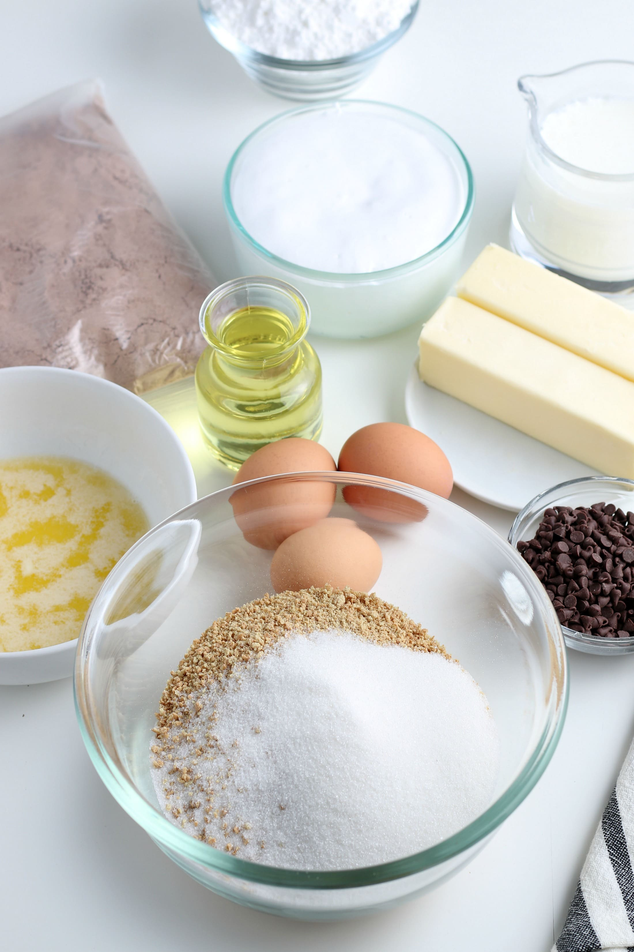 ingredients for graham cracker crust in a glass bowl.