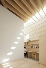 Japanese studio mA-style Architects has used large perimeter skylights to throw natural light across a grid of exposed wooden ceiling beams in order to flood the interior of the 'Light walls house' | Courtesy Architonic