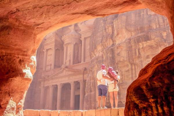 The Traveling Red and her family looking out at Petra