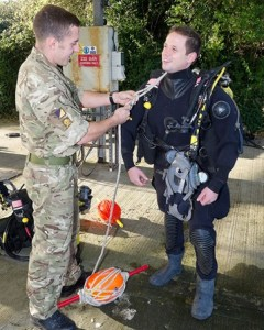 Surg Lt Jamie Vassallo being prepared for army diving session