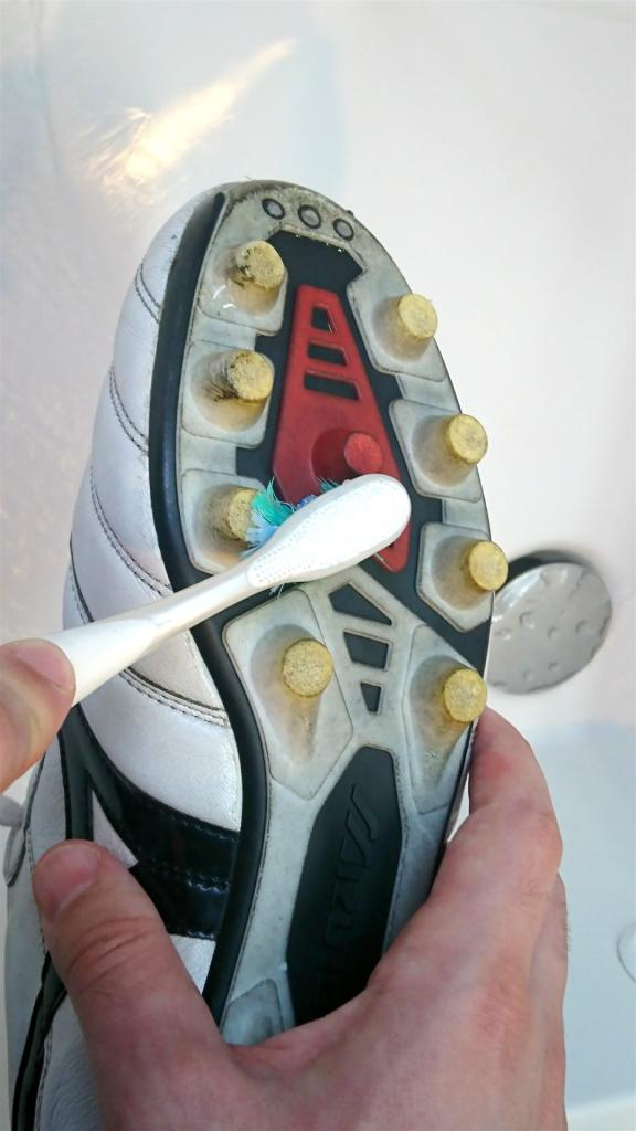 cleaning your football boots with a toothbrush