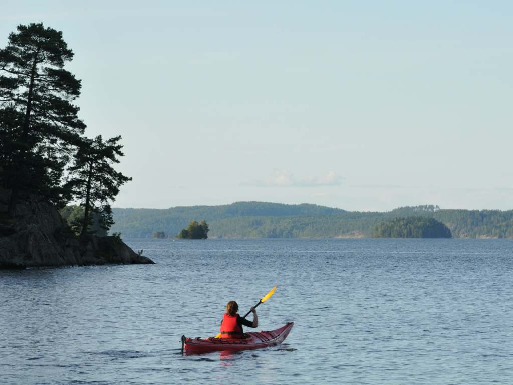 Kayak Paddler at lake in Dalsland