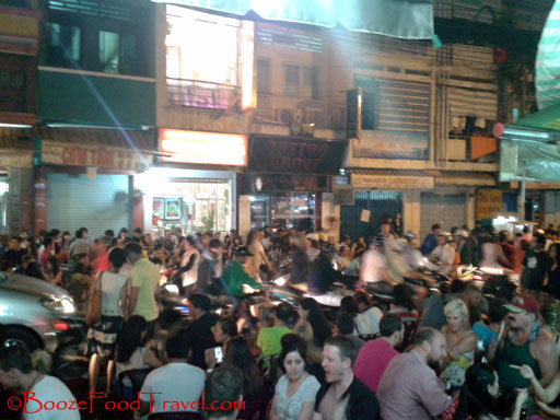 Crowded Saigon backpacker area is perfect for noisy conversation