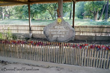 Many visitors leave trinkets for the victims of the Khmer Rouge