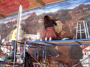 Touching up the murals at Wat Phra Kaeo, Bangkok