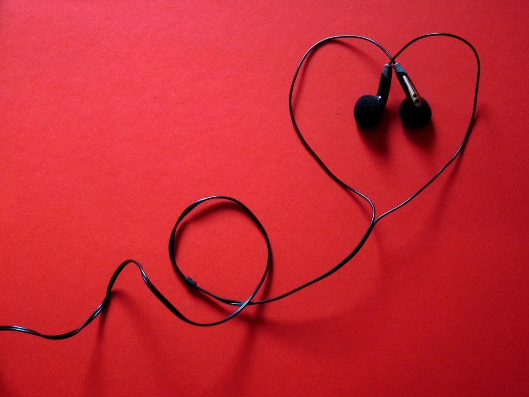 Phones with cord drawing a heart - Boom Podcast