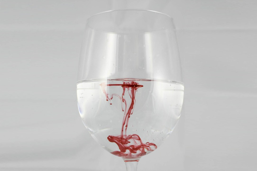 Blood in water in Wine Glass- alcohol Kills
