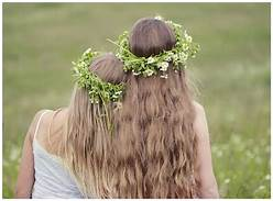 Two women with flowers in their hair sober serenity