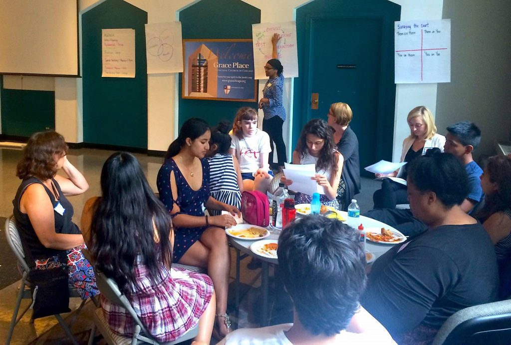 a small group of young people discuss Islamophobia with George Friday