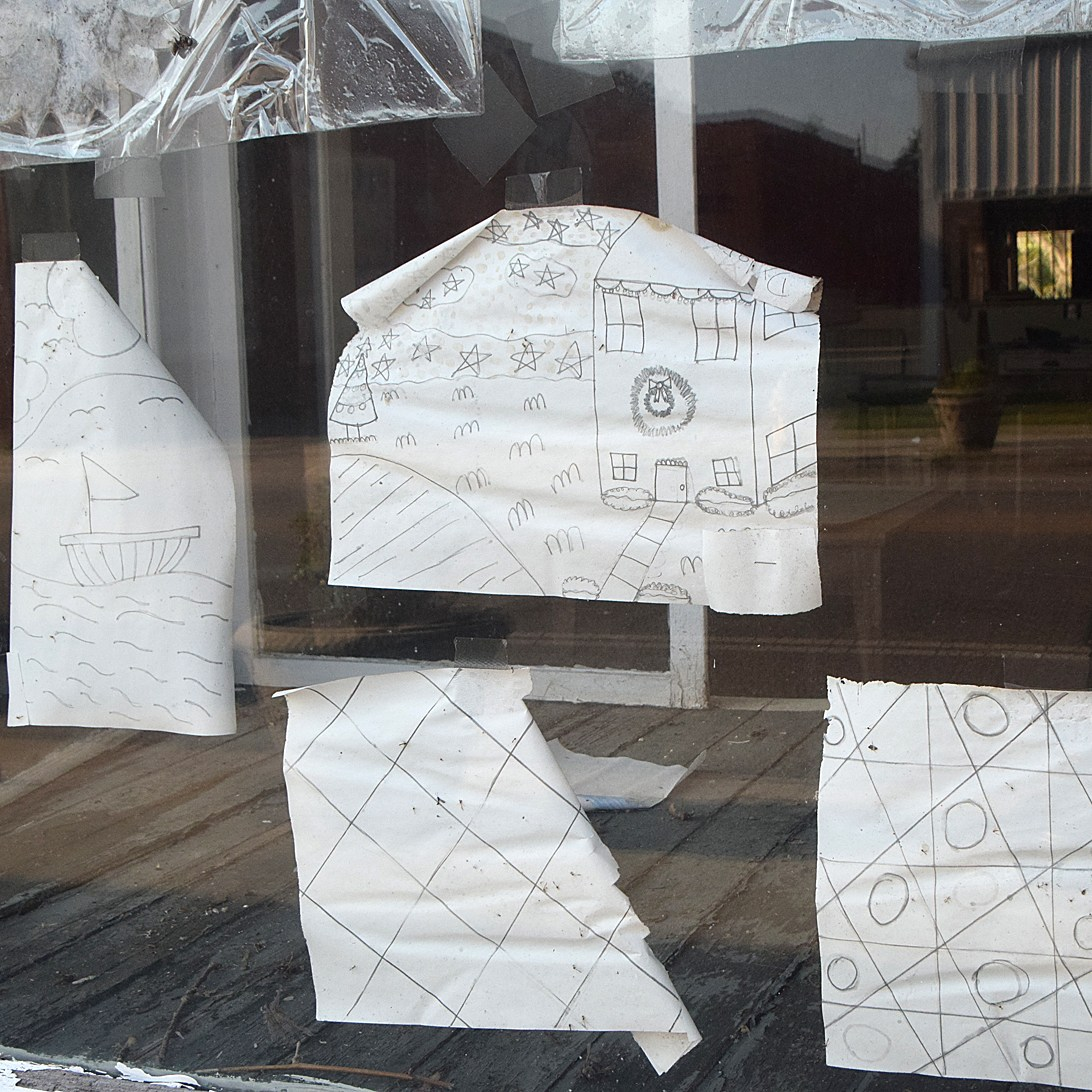 Christmas art in an abandoned storefront. Photo by Les High