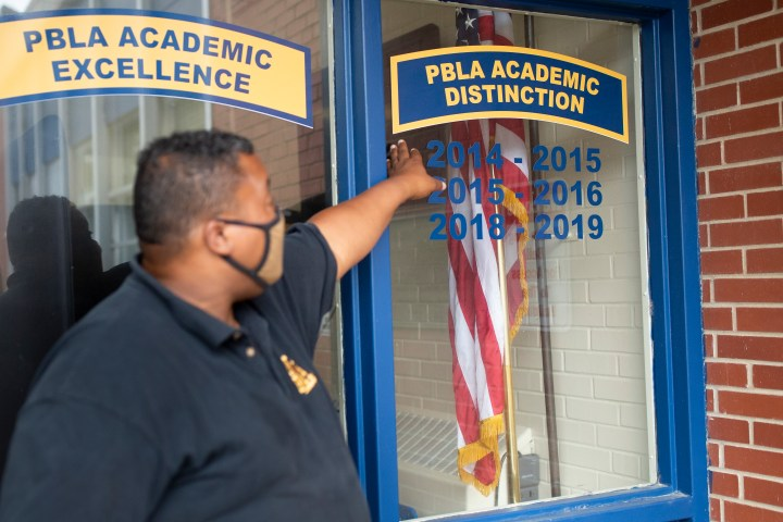 Colonel Carl Lloyd points out academic distinctions that the Paul R. Brown Leadership Academy has achieved.