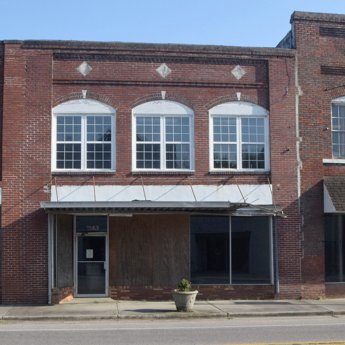 The plan is to raze Fair Bluff's historic downtown buildings to make way for a large park that could be used by river travelers. Flood waters from two hurricanes rendered these buildings structurally unsound