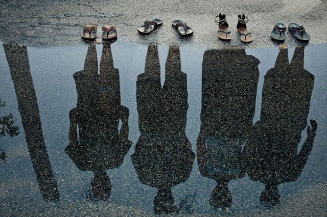Shadow Family. Well-placed sandals, a puddle of water, the right amount of light and there you have it, a reflection of your family portrait. Source: FLIGRAFIE PHOTOGRAPHY