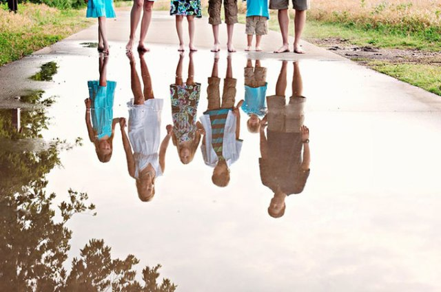 Reflections Capture your family's reflection in still water for a unique and interesting photograph. LIZLABIANCAPHOTOGRAPHY.COM
