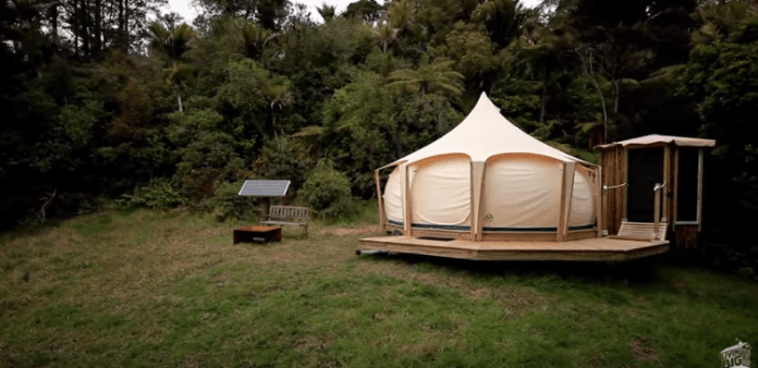 Ever heard of a lotus belle tent? If not, you're about to be amazed. This man is living inside this gorgeous tent in the forest while his tiny house is being constructed. The tent itself is beautiful, but wait until you see what he's done to the inside! Absolutely lovely.