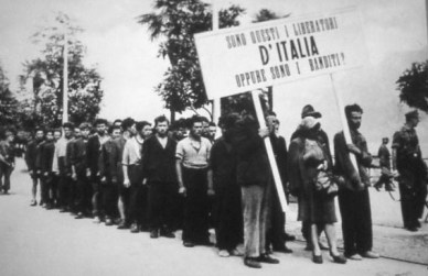 "The sign reads ""Are these the liberators of Italy or are they the outlaws?"" from www.montagnavissuta.it"