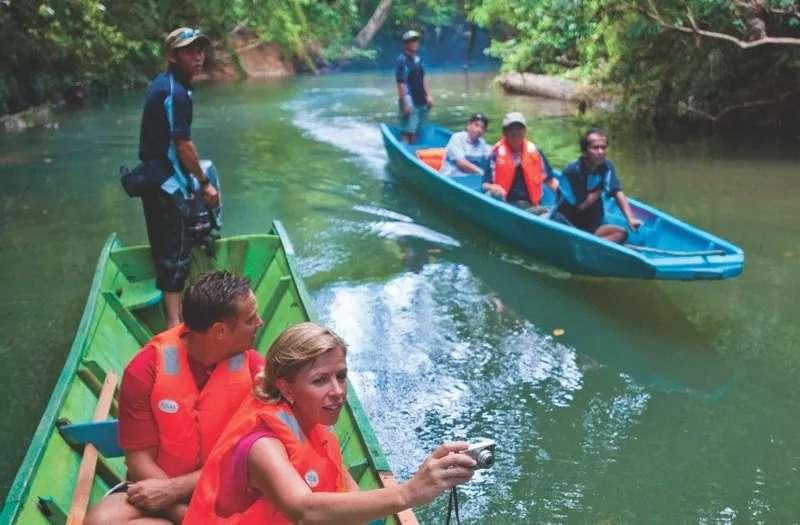 Tourists travelling by longboat to Ulu Temburong, Brunei