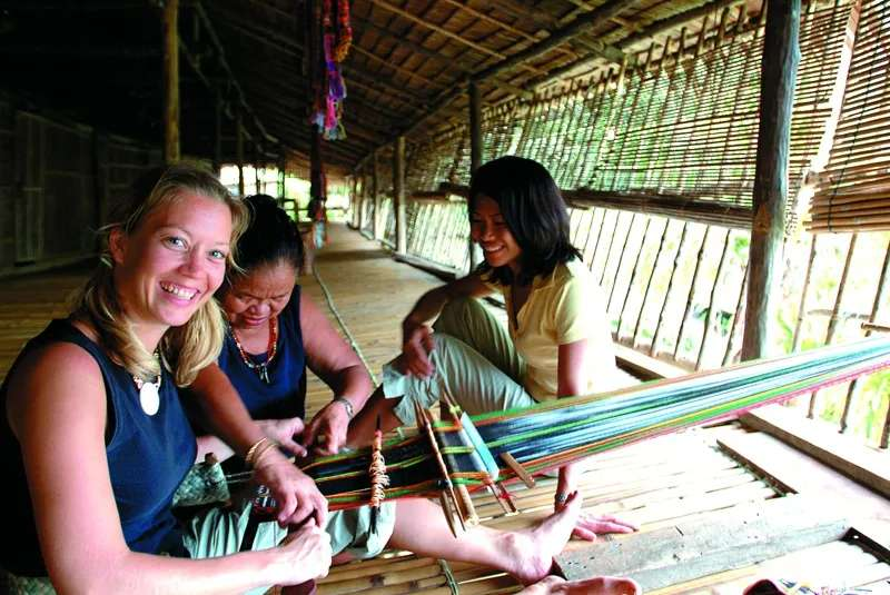 Weaving demonstration at Rungus Longhouse in Kudat district, Sabah, Malaysia