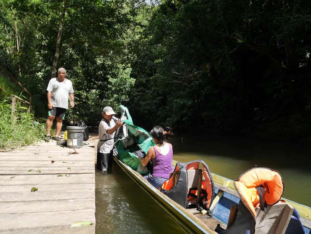 Packing the longboat at Lubok Kasai jungle camp