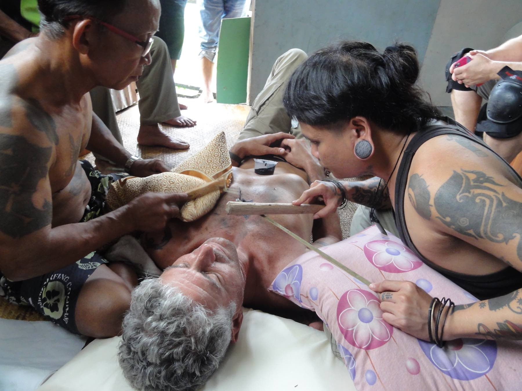 Anthony Bourdain gets a hand tap tatttoo, Borneo