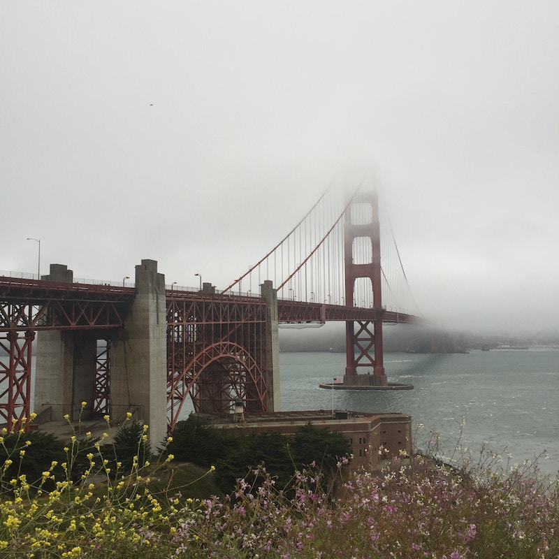 The Golden Gate Bridge partially hidden by clouds