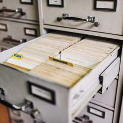 A filing cabinet drawer containing index cards