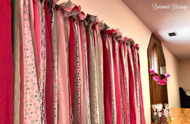 DIY Fabric & Ribbon Garland Backdrop - BorrowedBlessings.net