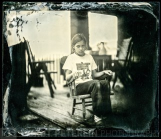 Lučka sitting on a rocking chair portrayed with Petzval lens