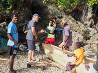 A tradition ... carving out a dug-out canoe
