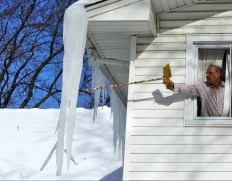 Breaking icicle with broom ed