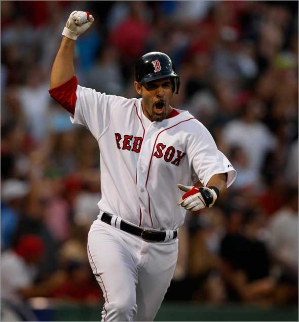 Boston Red Sox third baseman Mike Lowell reacts to his 3 run HR in the 7th.
