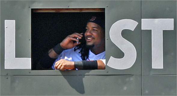 During a sixth inning pitching change, when Red Sox starting pitcher Josh Beckett was removed from the game, Red Sox left fielder Manny Ramirez went inside the Green Monster, and was seen smiling and apparently talking on someone's cellphone.