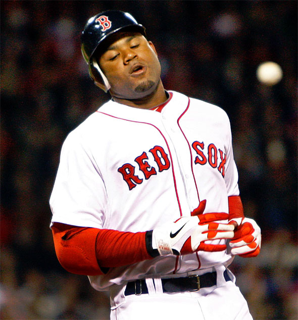 The Red Sox Carl Crawford reacts after he grounded out in the first inning. Yankees 1B Mark Teixeiratosses the ball around the infield in the backround. The Boston Red Sox hosted the New York Yankees at Fenway Park.