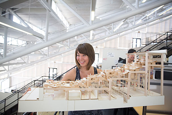 Harvard Graduate School of Design PhD student, Lauren Friedrich's thesis researched how architecture can facilitate physical well being and what that means for workplace design. Here she is seen in Gund Hall with her model of proposed Gund Hall renovations. Harvard University. Kris Snibbe/Harvard Staff Photographer