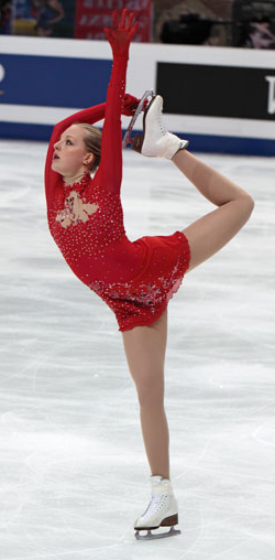 young female figure skate in full extension