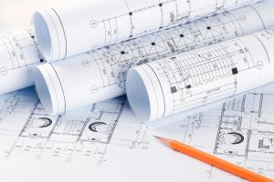 Landscape design plans rolled up with pencil
