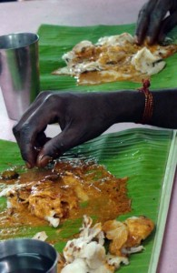 Eating a banana curry from a banana leaf plate.